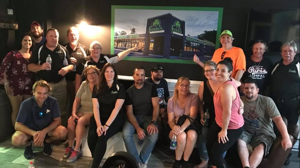 The Bath & Kitchen team enjoying a night at the ballpark at the newly renovated Ferris Home Improvements Blue Rocks suite. The company offers first come first serve to any game in the suite for its employees.