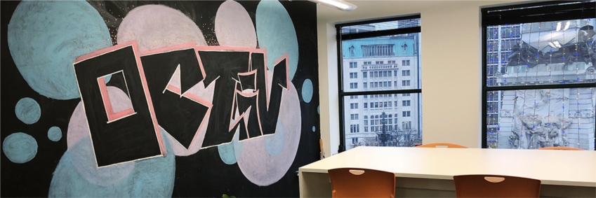 The Octiv office lobby features original artwork from our own team, and a great view of Monument Circle!