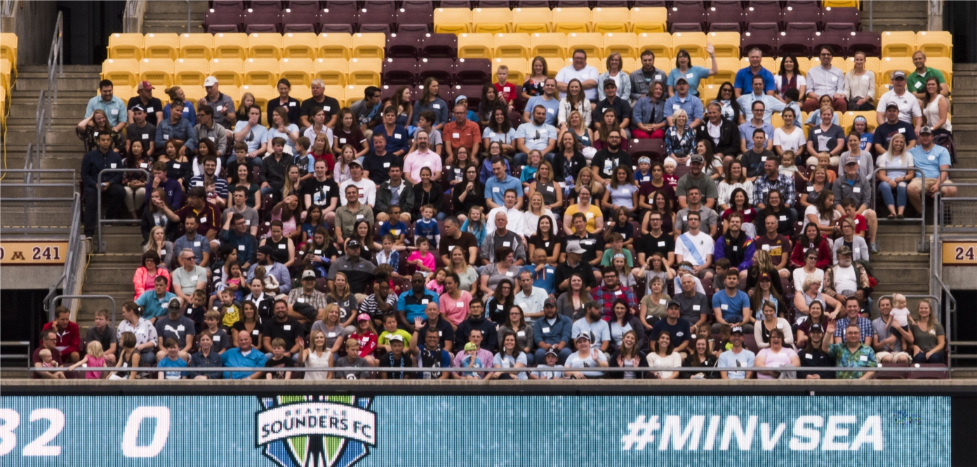 WSB staff cheering on the MN United at the annual summer picnic.