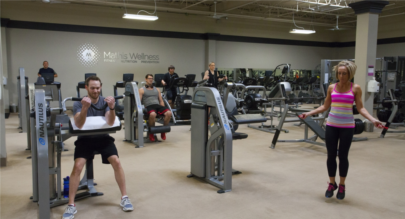 Employees improve their health inside our onsite Mathis Wellness Center with the help of our staffed personal trainers.