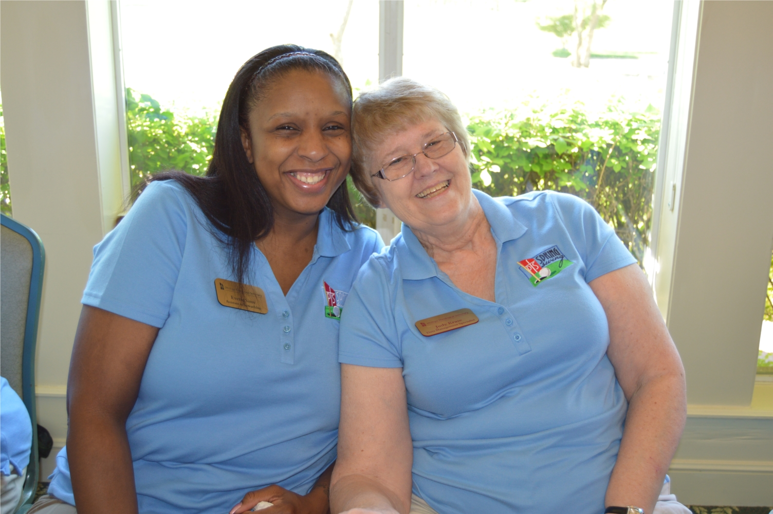 Phillips employees Evette Sims and Judy Krase enjoy the Seminary's annual golf tournament
