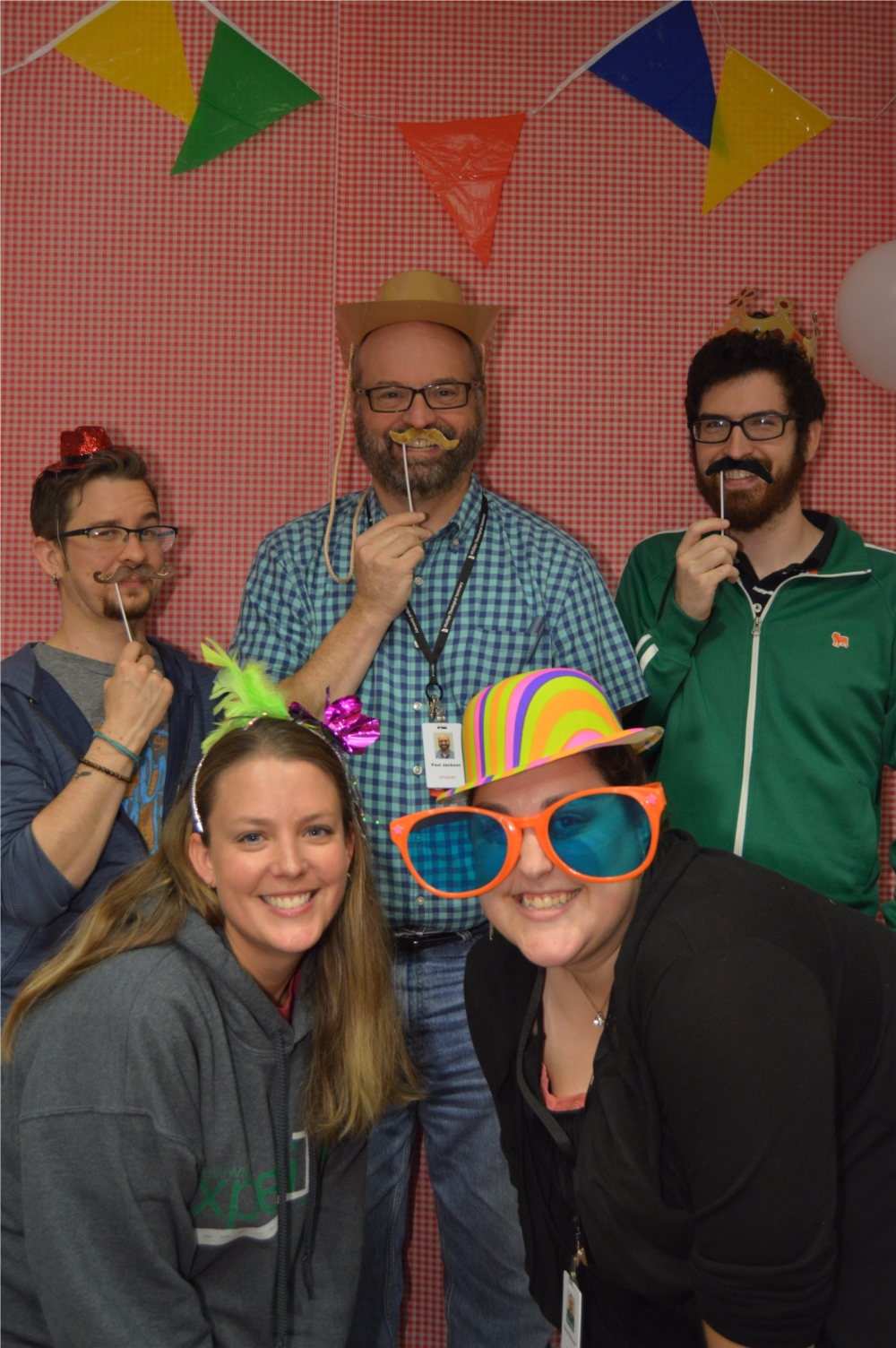 A group of Phillips students enjoy the photo booth at the fall carnival.