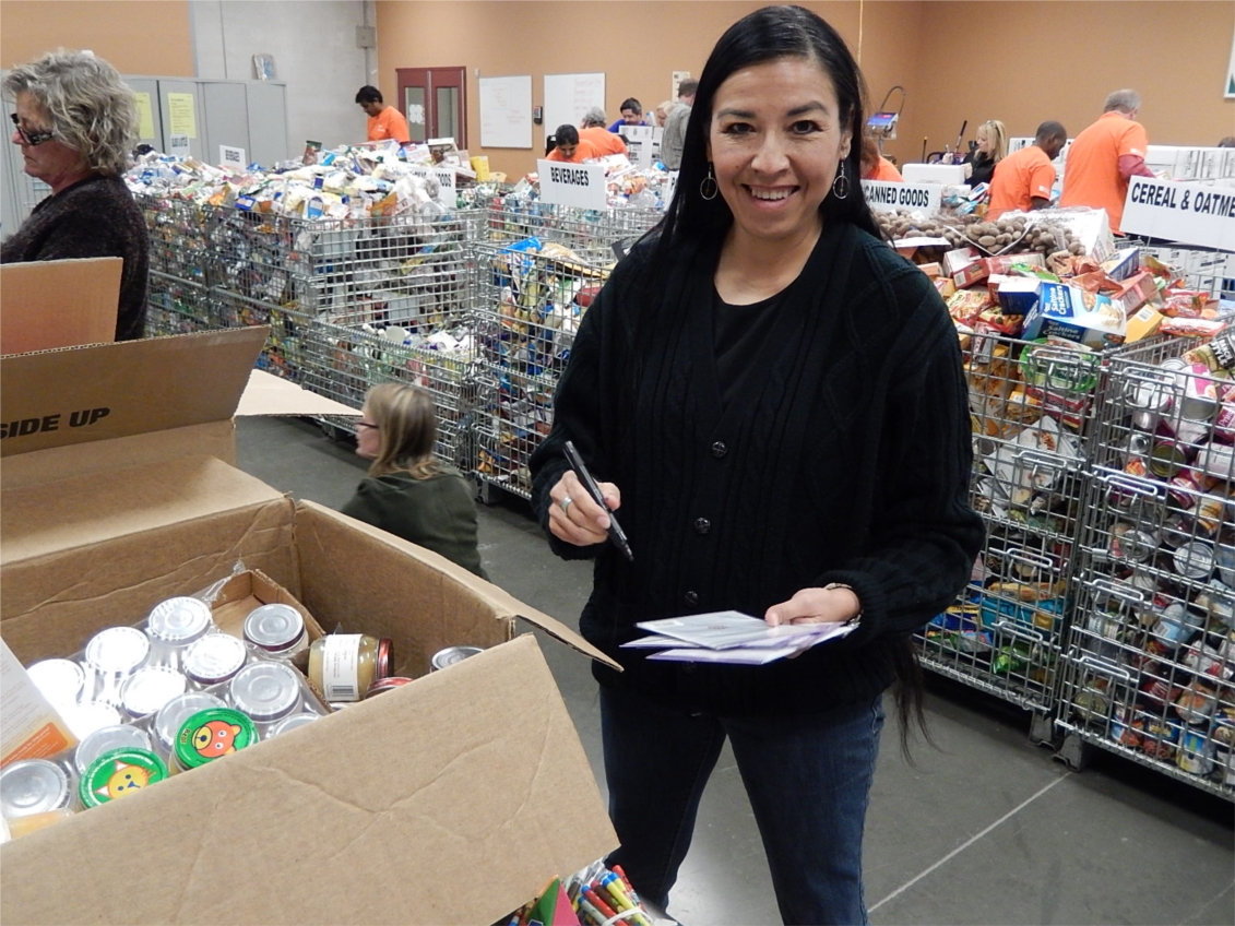 Phillips Director of Admissions Judy Aaron was a part of a group of Phillips employees who recently volunteered at a local food bank.