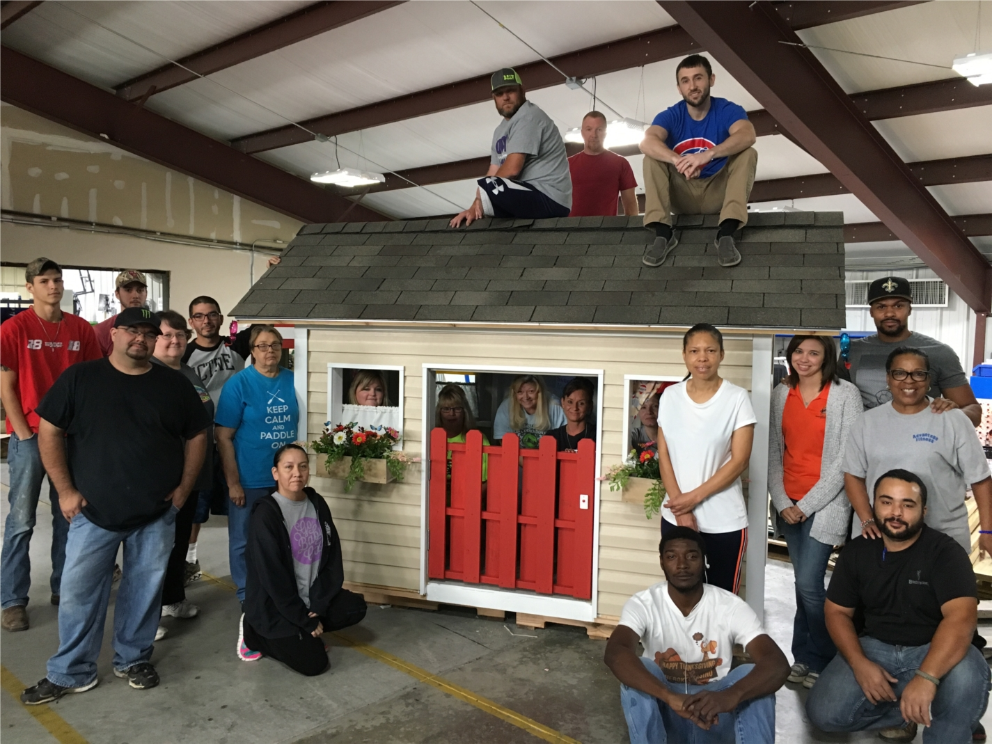 Advantage Controls team members built playhouses to help support CASA as part of the United Way Day of Caring