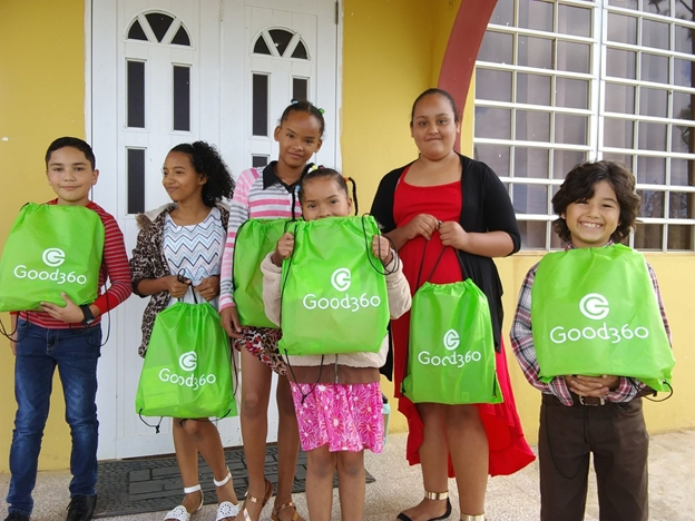 Good360 Hygiene Kits with Kids in PR.png