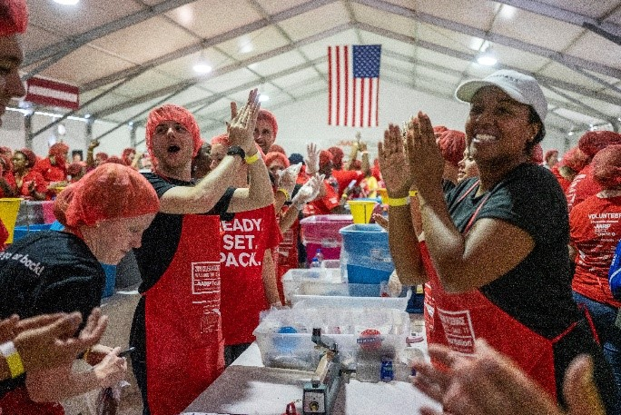 AARP staff volunteer at AARP Foundation's annual Celebration of Service Meal Pack Challenge on the National Mall.