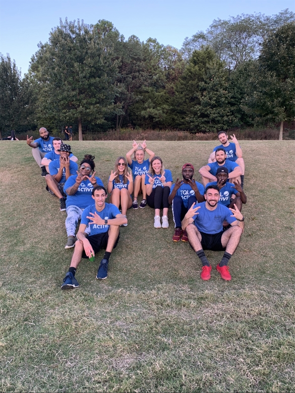 TQL Atlanta's co-ed kickball team celebrated the return of live sports by winning their league championship