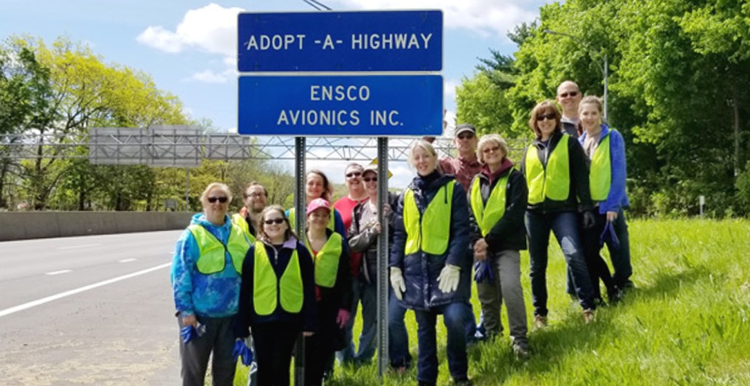 ENSCO Avionics – Employees volunteering to clean up for the Adopt-A-Highway Program