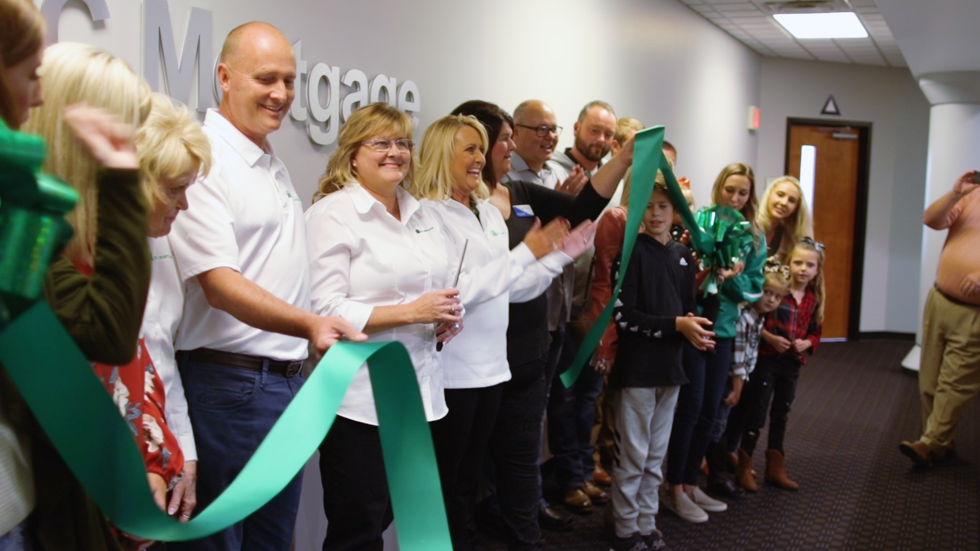 Ribbon cutting at new corporate office location