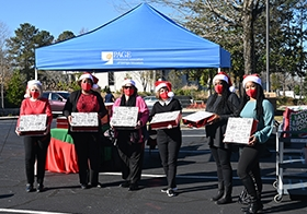 For 2020, the PAGE Social Committee pivoted from its traditional holiday celebration and opted to throw an outdoor drive-through party.