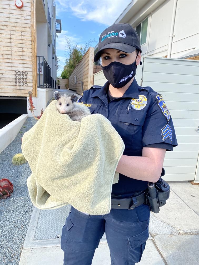 Sgt Regina Price with Opossum.jpg