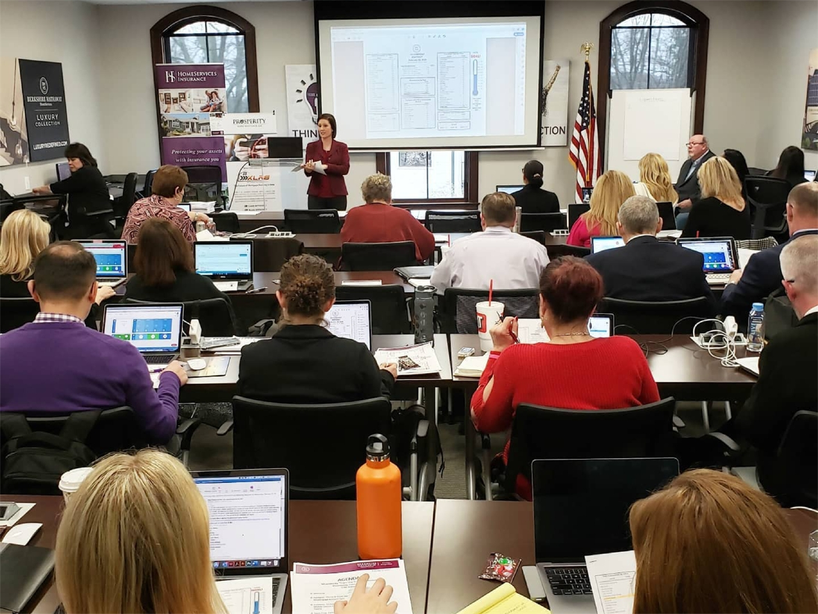 Professional development training session with employees and agents.