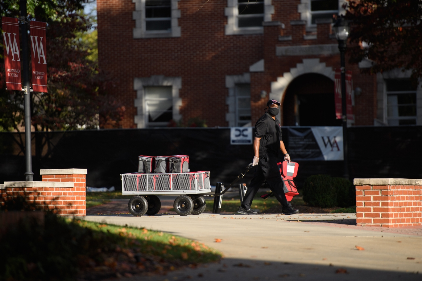 Dining services staff delivering food around campus.jpg