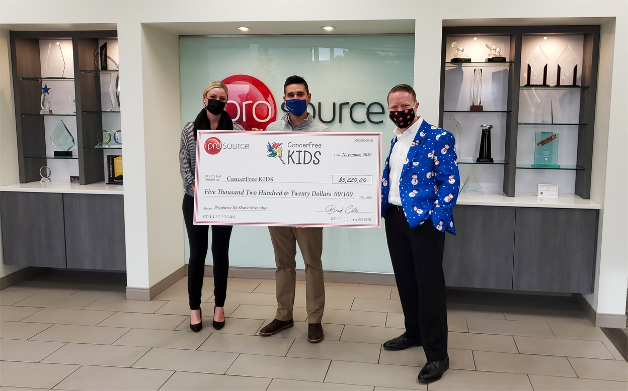 Prosource team members present a fundraising check to CancerFree KIDS,