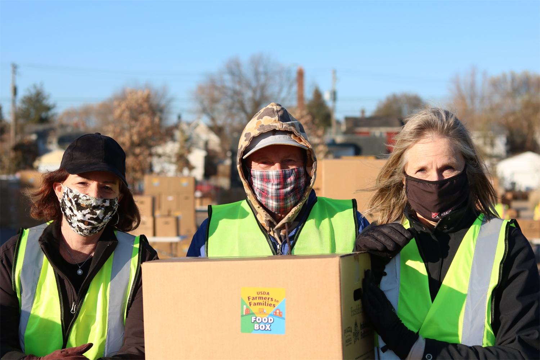 Distributing food boxes to needy neighborhood