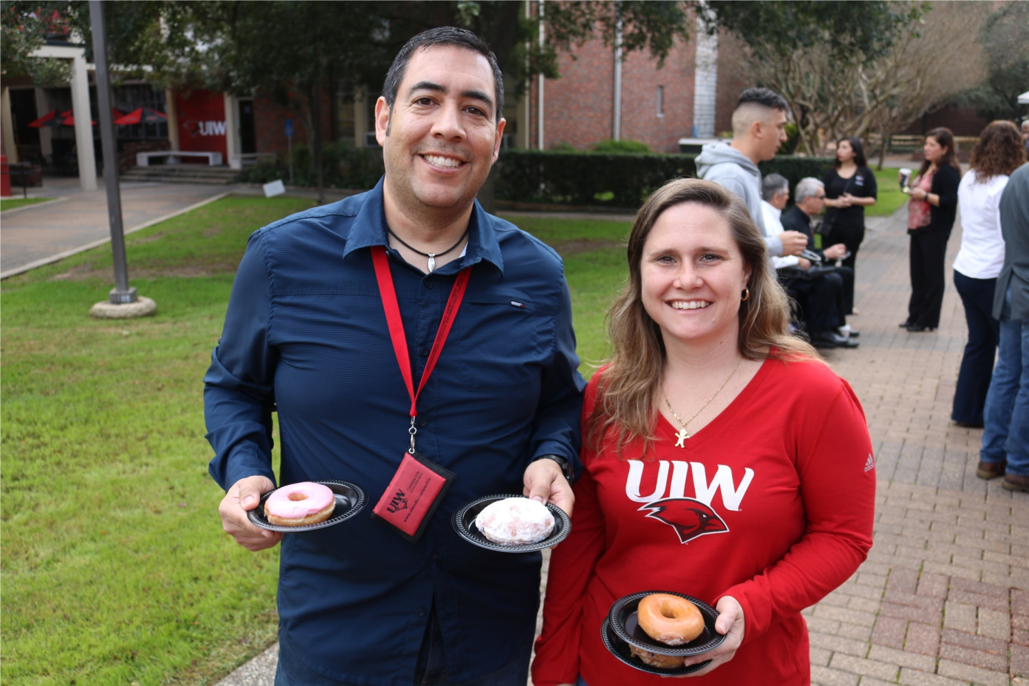 Employees enjoying coffee and doughnuts during the Spring Welcome Back event held each year after Christmas break.