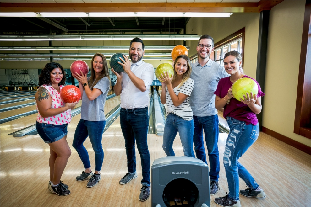 Colleagues show off their bowling -- and posing -- skills during Employee Appreciation Day 2019 at Pinstripes.