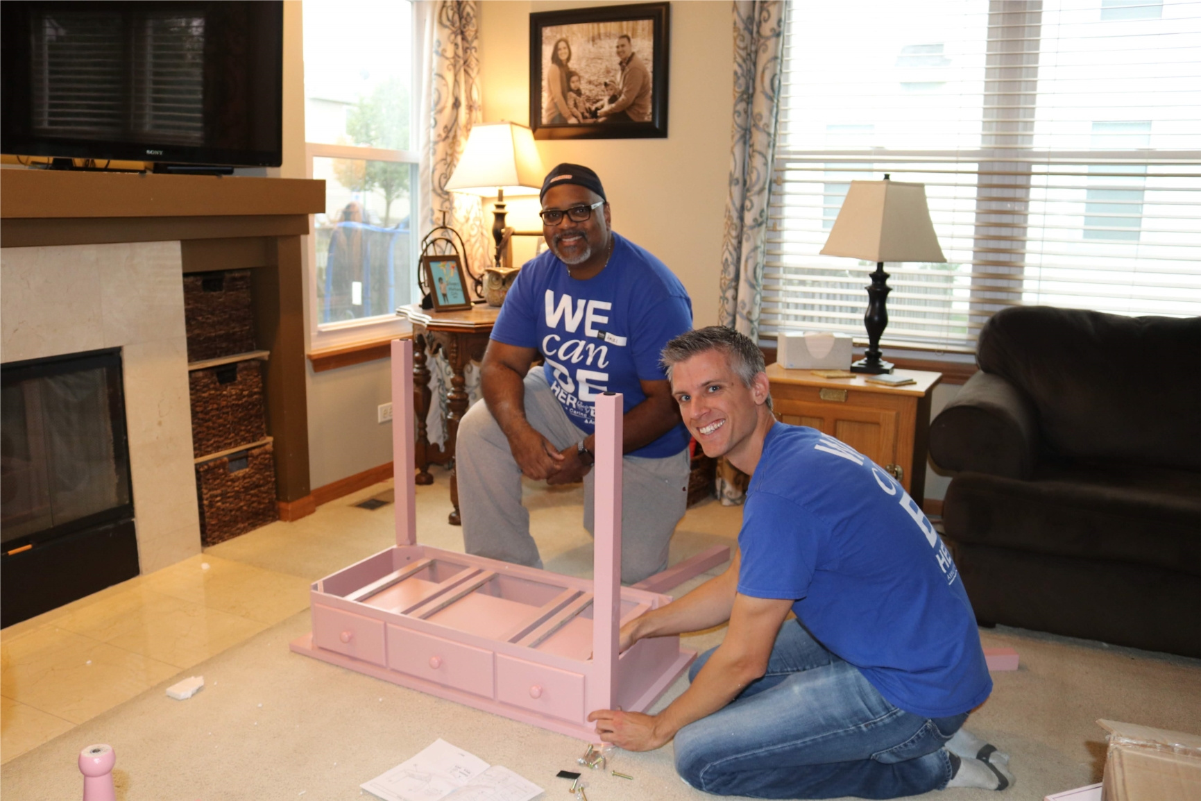 Assurance volunteers help build a dream bedroom for a terminally ill child through the Assurance Caring Together partnership with Special Spaces.