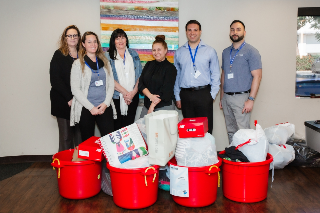 New American Funding employees at corporate headquarters collecting items for clothing drive