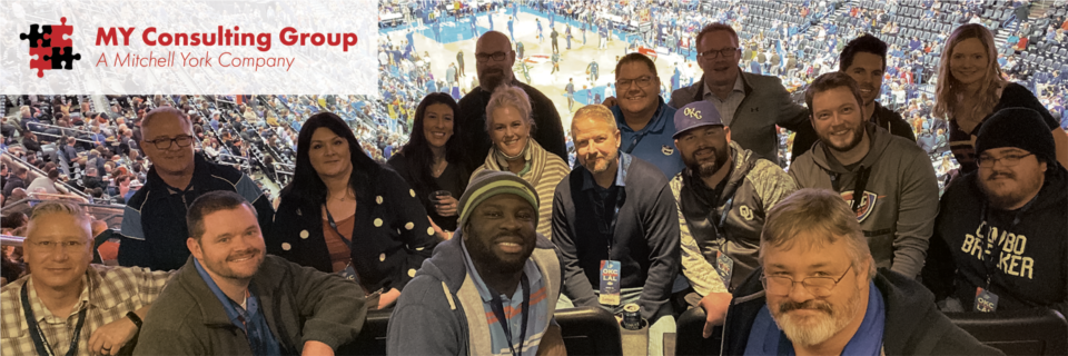 The MY Consulting Group team enjoying a Thunder game
