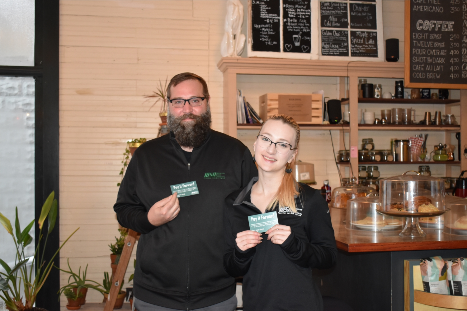Employees paying it forward at a local coffee shop during our annual Pay It Forward week.