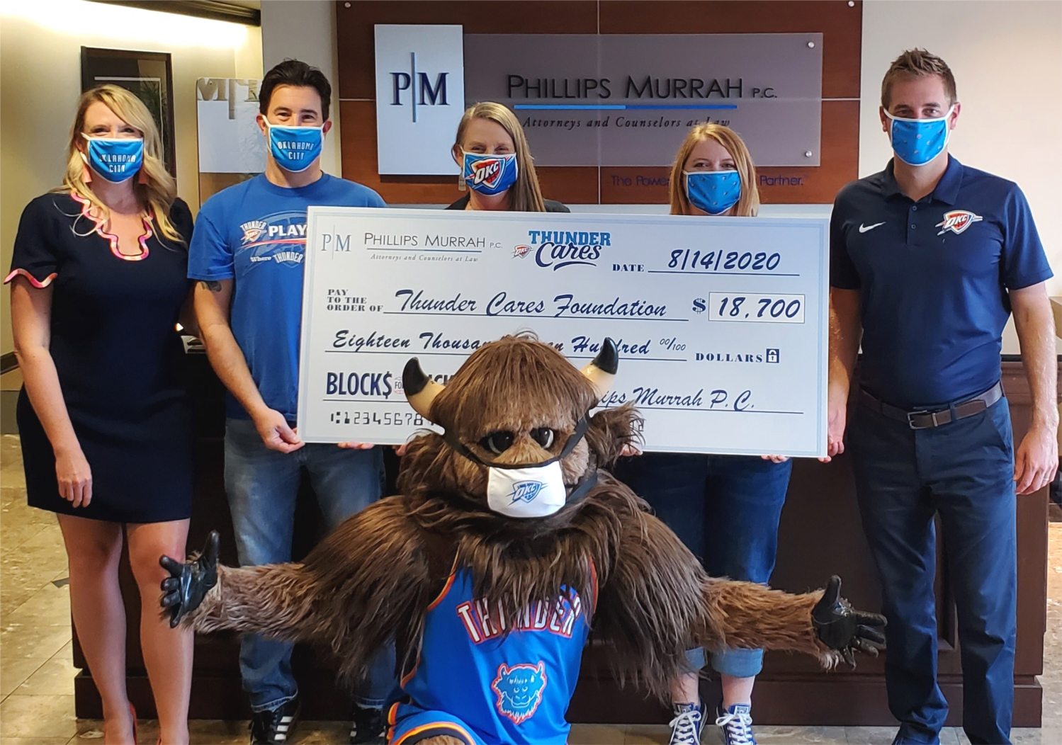 Phillips Murrah presents a check to Thunder Cares Foundation as part of the Firm's partnership with the Oklahoma City Thunder Basketball's Blocks for Bucks campaign.