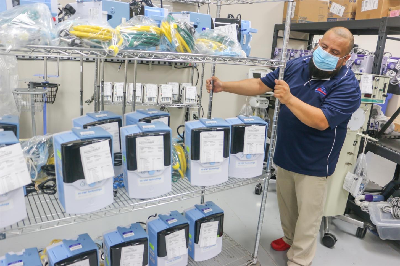 USME employee preparing essential medical equipment for shipment to hospital partners.