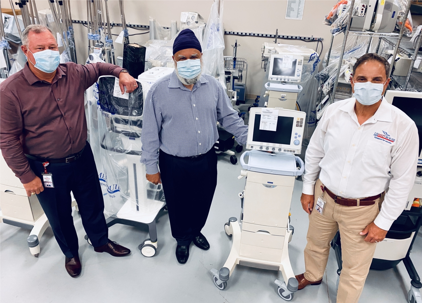 USME Leadership with essential medical equipment ready for shipment to hospital partners during the height of the Covid-19 pandemic.