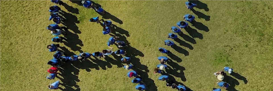 Team picture from when we could get together, we made our logo with team members and someone's drone.
