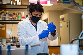 Staff Scientist, Shylesh Bhaskaran works his magic in an OMRF Aging & Metabolism Research Program laboratory.