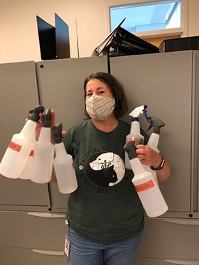 Safety first! Cindy Carter, OMRF Laboratory Manger, distributes bottles of disinfectant around the organization.