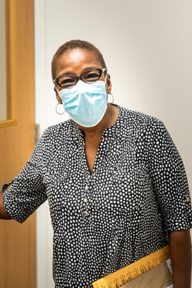 """Can you see my smile underneath this mask?"" Fredonna Carthen, Clinical Trial Project Administrator, still smiling after over 23 years at OMRF."