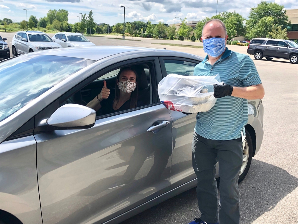Associates attend drive thru event to pick up meals to support local restaurants in response to COVID-19