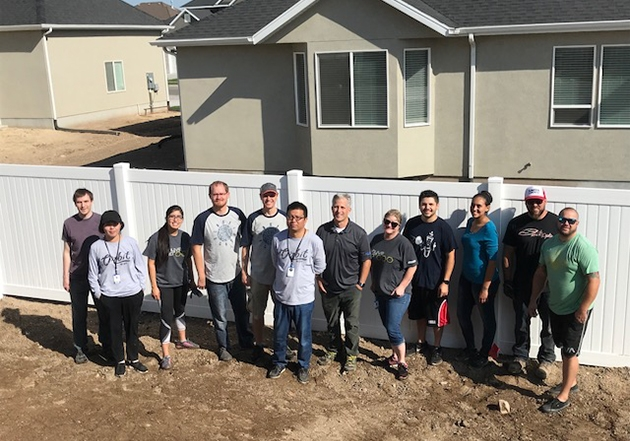 """Orbit's team donating product and the muscle behind it at a """"charity dig"""", giving back to the community."""