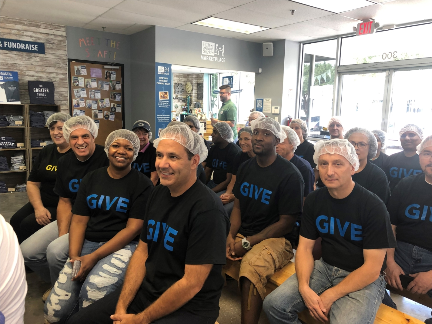 NASCO CEO, John Ladaga, and associates in Plano, Texas giving back by packaging meals for starving children.