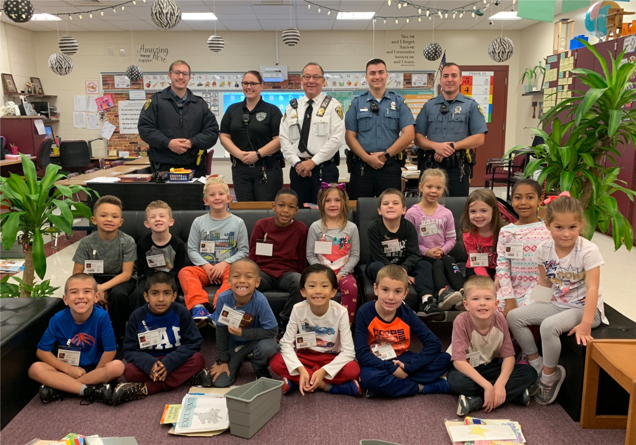 Bethel Township Police Department visits Bethel Springs Elementary School to award students with medals honoring them as Word Detectives!