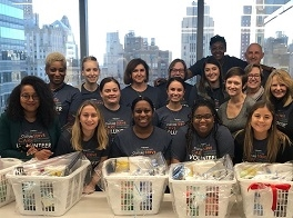 Glenmede employees volunteered with ACHIEVEability and prepared welcome home baskets for low-income families.