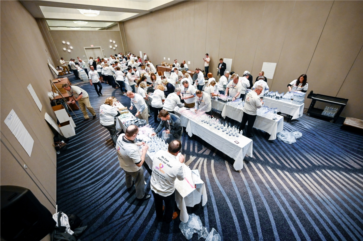 Approximately 100 CareCentrix leaders assembling and boxing over 1,000 hygiene bags for the Homeless in Tampa.