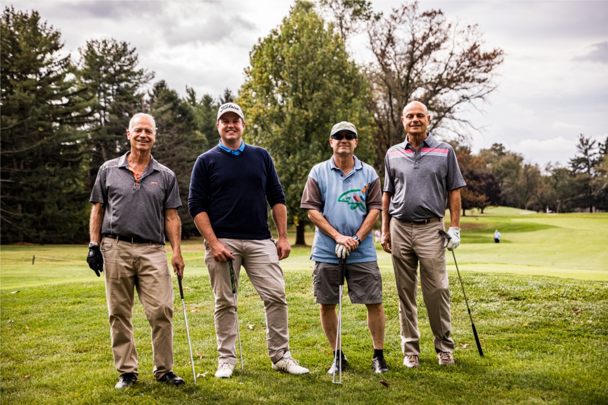 Hankin Group Invitational Golf Tournament leader foursome.