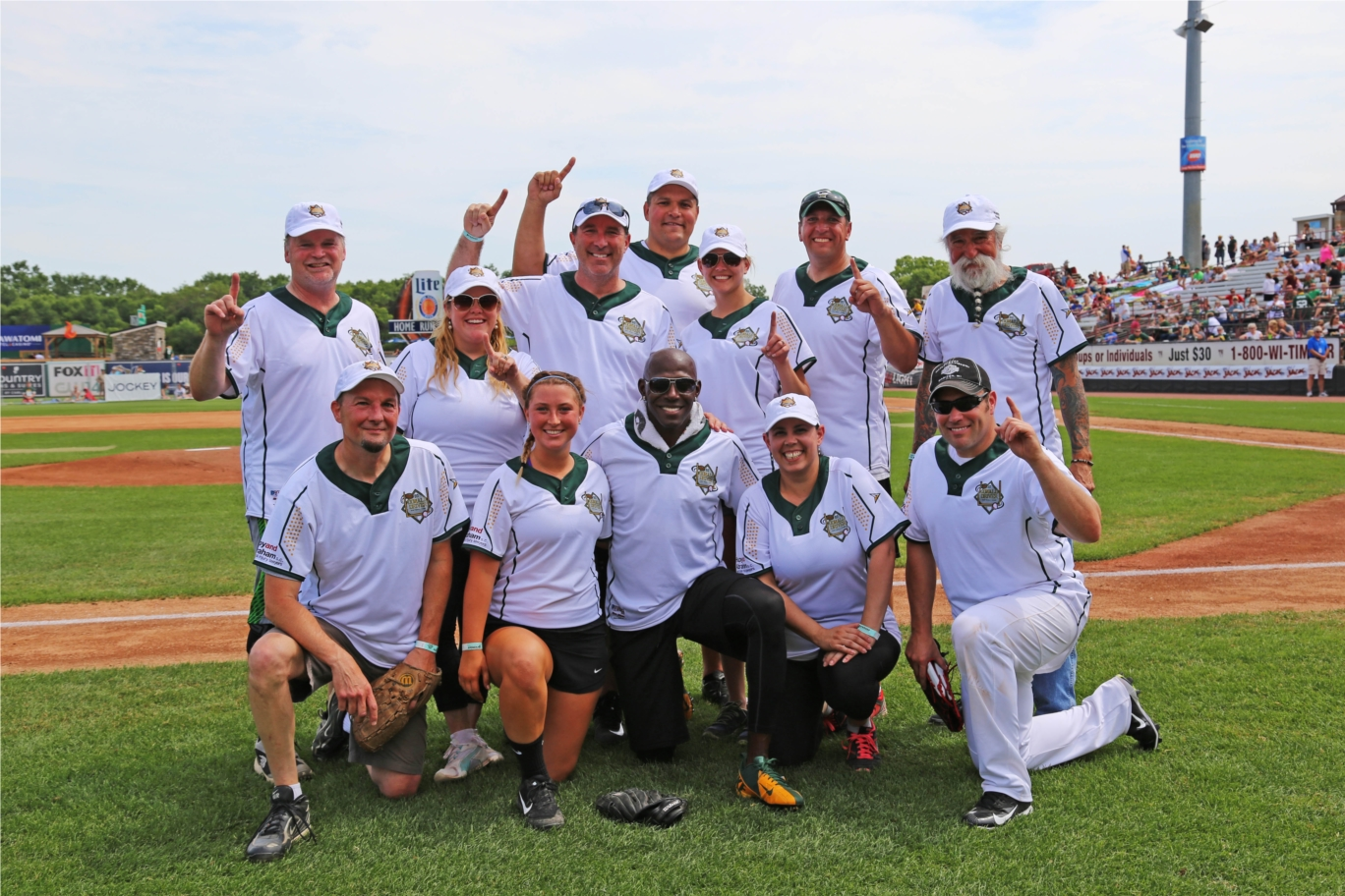 Hupy and Abraham Employees with Donald Driver at Charity Softball game