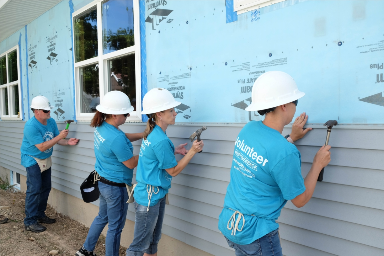 Hupy and Abraham employees volunteering at Habitat for Humanity home.