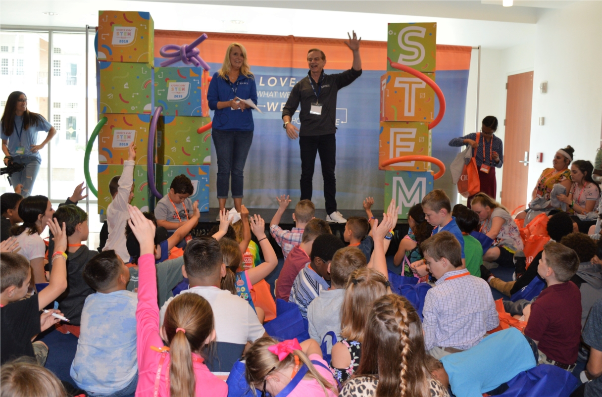 Kforce COO Kye Mitchell and CMO Andy Thomas engage students and their families at the firm's first Kforce Kids' STEM Fair in 2019.