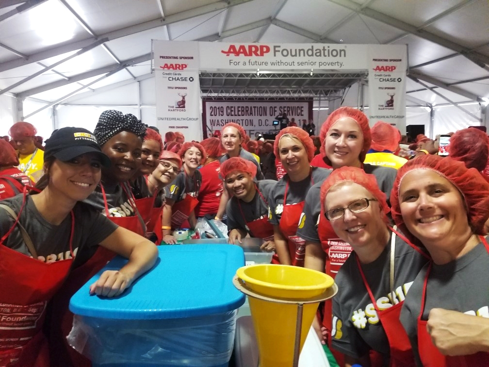 Employees participated in the AARP meal packing event in DC.