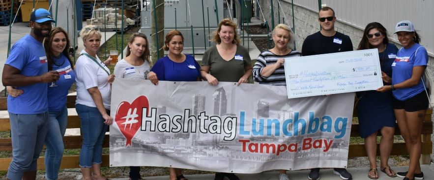 #Lunchbag Tampa Bay Our team members volunteer to make sandwiches, pack hundreds of colorful bagged lunches, and deliver the food to the homeless at nearby parks.