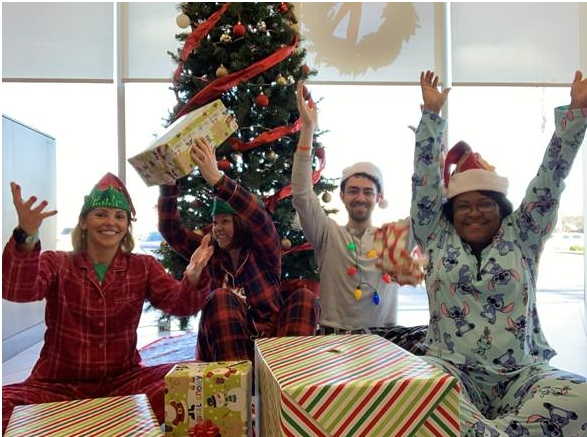 Pinnacle associates in the Upstate share some Christmas joy after hosting a gift-wrapping station for clients. Clients brought gifts into the office and enjoyed hot chocolate while associates wrapped the gifts.