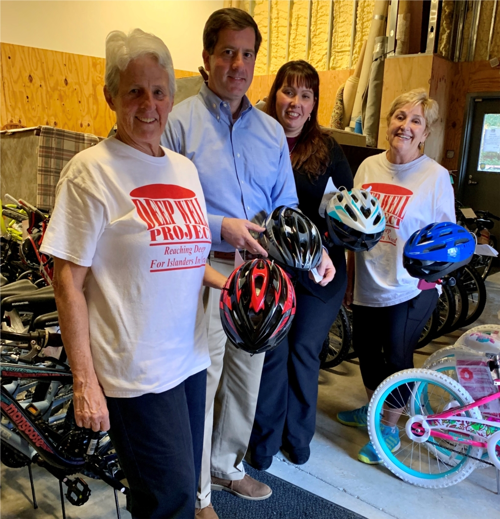 Pinnacle associates in Hilton Head partnered with the Deep Well Project by providing bicycle helmets to accompany bikes that had been donated for children served by the organization.