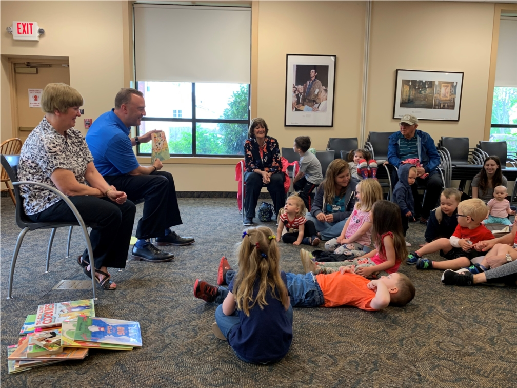 Jeff Schweitzer, President and CEO of Univest Financial, reads to children at a local library during Financial Literacy Month.