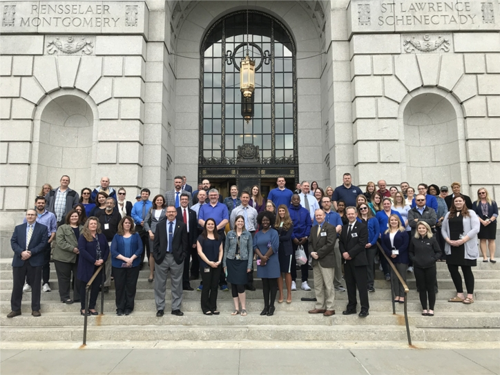DCJS employees dressed in blue to remember fallen police officers as a procession of police agencies pass by to attend 2019 ceremony.