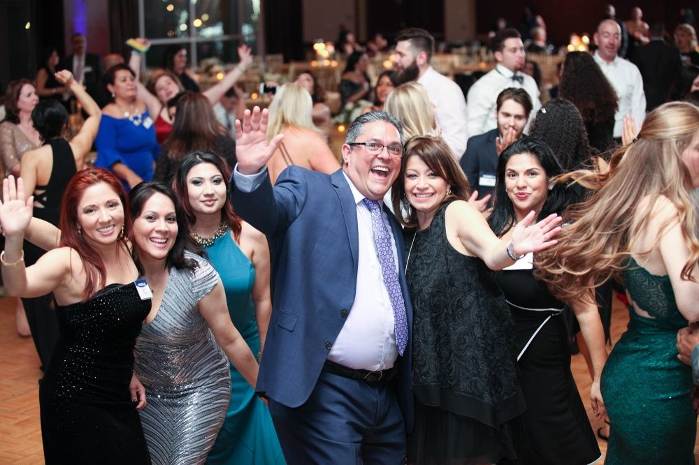 Co-workers having a great time celebrating HOMESTAR's success at our Annual Ball