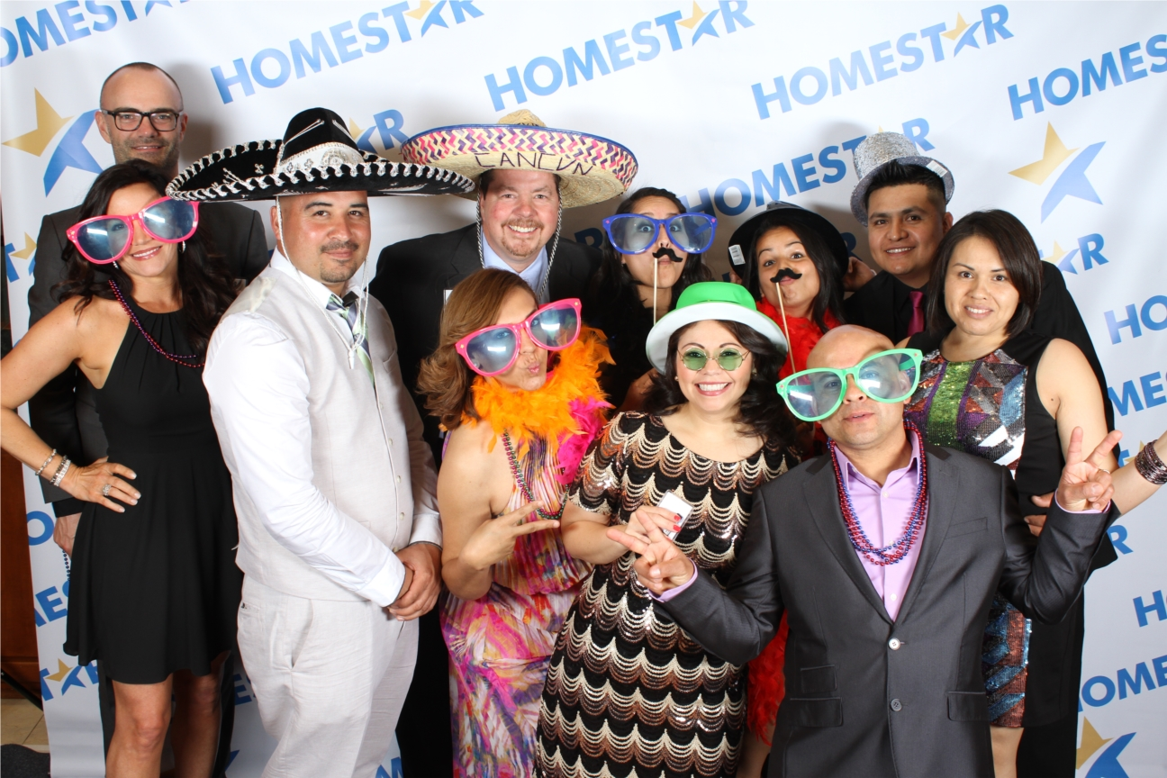 Acting silly and having a fun time with co-workers at HOMESTAR's Annual Ball